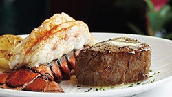 A surf-and-turf dish with a lobster tail and steak.