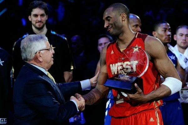 Kobe Bryant shakes hands with David Stern while holding his All Star Game 2011 MVP award.JPG